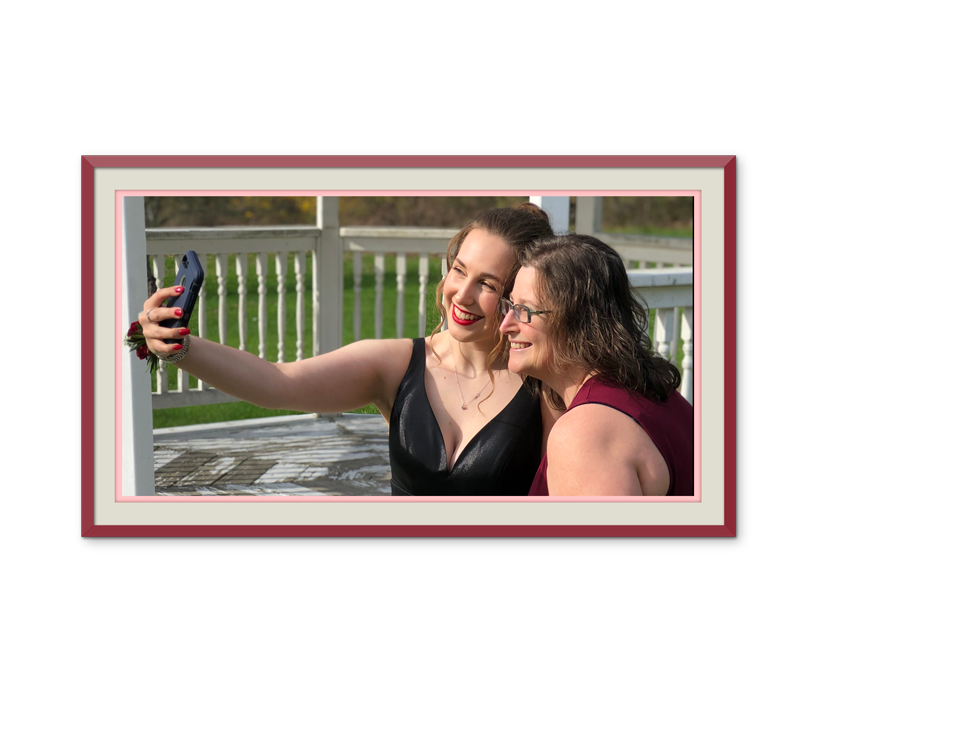 mother and daughter taking a selfie before the prom